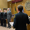 Joed Viera/Staff Photographer- Lockport, NY- Richard Gowanlock, Joshua Wolck, Adam Turton and Timothy Lundquist are sworn in as the City's new firefighters by fire chief Pat Brady during a ceremony in the City Council Chamber.