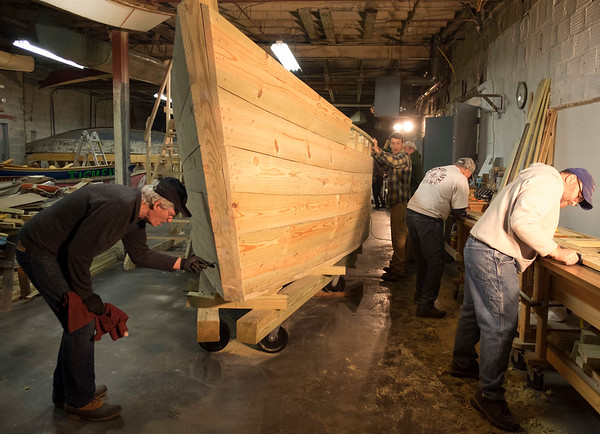 "Work is continuing on the Durham-style boat that is being constructed by 30 volunteers at the Buffalo Maritime Center. When finished, the boat will be placed in the water at Lockport's Flight of Five, to demonstrate how the old locks worked. Here, volunteer boat-builders work on the ""Erie Traveler"" at the Buffalo Maritime Center in Buffalo, N.Y. on January, 31st 2017.(Joed Viera/Lockport Union-Sun & Journal)"