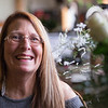 Joed Viera/Staff Photographer- Lockport, NY- Cynthia Hahn-Davis sits by some of her arrangements at her flower shop.