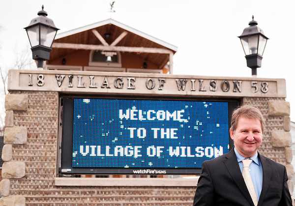JOED VIERA/STAFF PHOTOGRAPHER-Wilson, NY-Wilson mayoral candidate Arthur Lawson stands by the village's sign. Lawson is running unapposed.