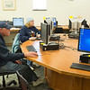 Joed Viera/Staff Photographer- Lockport, NY-Patrons wait at computers during a temporary internet outage at the Lockport Public Library on Thursday.