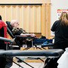 Joed Viera/Staff Photographer-Lockport, NY-Robert Nowakowski, center,  sits in a chair waiting to donate as Maddie Clark, right, and Tina Cancar, left, organize during the American Red Cross' Blood Drive at South Lockport Volunteer Company.