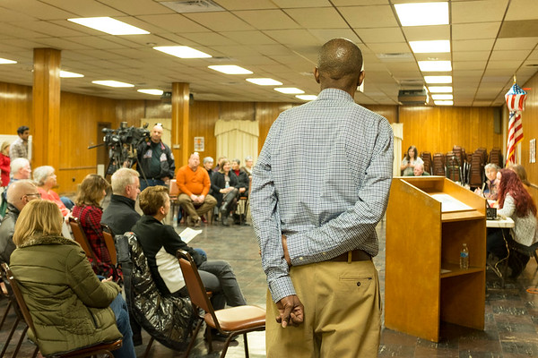 JOED VIERA/STAFF PHOTOGRAPHER-Lockport, NY-1199SEIU political coordinator Maurice Brown listens to  panelists Kyle Lambalzer, RN, Dr Margaret Libby, small business owner Diana Kastenbaum and Kimberly Kornowski, RN along with the Dozens showed up to the Town Hall style meeting held by the 1199SEIU at the American Legion on Niagara Street.