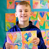 JOED VIERA/STAFF PHOTOGRAPHER- Newfane, NY-Newfane Elementary School 3rd-grader Levi Henning, 7, holds up a painting of hearts he made after learning about warm and cold colors during the School's Pride in Community Club art class. Students from PICC made  smaller, similar versions of the paintings inspired by 70 year-old Ohio artist Jim Dine to give to the Niagara County Sheriff's Department as Valentines Day cards on Wednesday.