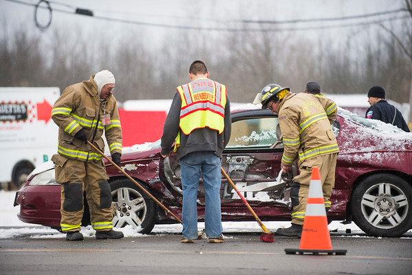 JOED VIERA/STAFF PHOTOGRAPHER-Lockport, NY-Wendelville and Rapids Volunteer Fire Companies work at the scene of an accident on Transit Road and Rapids Road.