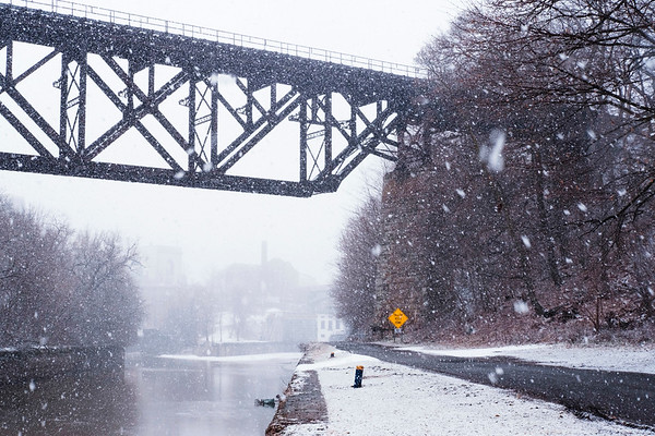 Snow falls on the Upside-Down Bridge and the Canalway Trail at Upson Park on Wednesday, Feb. 15, 2017 in Lockport, N.Y. The Trail streches close to 300 miles along active and historic parts of the nearly 200 year old Canal.(Joed Viera/Lockport Union-Sun & Journal)