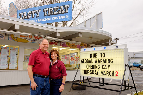 JOED VIERA/STAFF PHOTOGRAPHER-Lockport, NY-Tasty Treat owners Nanette Frey holds stand outside the  stand on Thursday. The ice cream stand is set to open for its 17th season on March 2nd. Although Tasty Treat traditionally opens on the first Thursday in March, this year they joked that it was due to global warming.