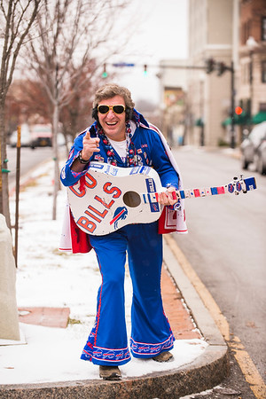 "Joed Viera/Staff Photographer- Lockport, NY-John ""Bills Elvis"" Lang holds his guitar on Main Street. Lang has dressed as the King at Buffalo Bills games for close to 25 years"