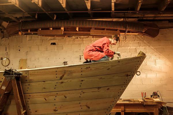 Joed Viera/Staff Photographer-Buffalo, NY-Carol Schmidt coats screws on the Erie Traveler Thursday at the Buffalo Maritime Center.