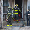 Joed Viera/Staff Photographer- Lockport, NY- City firefighters and police work at the scene of a fire on 67 Olcott Street.
