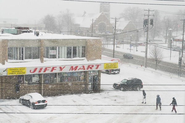 JOED VIERA/STAFF PHOTOGRAPHER-Lockport, NY-Snow falls over Lockport as seen from the thrid floor of Harrison Place.
