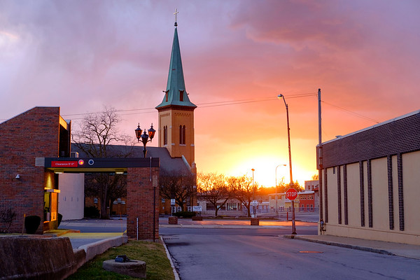 JOED VIERA/STAFF PHOTOGRAPHER-Lockport, NY-The Sun sets behind the former St Mary's Church Wednesday Evening.