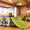 Joed Viera/Staff Photographer Lockport, NY-Starpoint Middle School students watch BMX performer Colton Civitello jumps over Patrick Root and Prinicpal Kathy Brachmann as a reward for participating in the school's Pick a Reading Partner Program