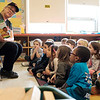 "Joed Viera/Staff Photographer Lockport, NY-Pizza Hut Ambassador Tracy McKee reads ""The Pizza That We Made"" to Margot Collins' Kindergarten class at George Southard Elementary School.  Students at the school received 1,000 books and a pizza party from Pizza Hut's The Literacy Project."
