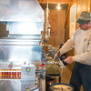 JOED VIERA/STAFF PHOTOGRAPHER-Middleport, NY-Jason Wolf checks the evaporator in the production room at Wolf Maple Products.