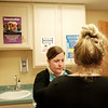 Joed Viera/Staff Photographer Lockport, NY-CHCB nurse practicioner Janelle Colquhoun attends to Carrie Carlson, a new patient at the CHCB facility.