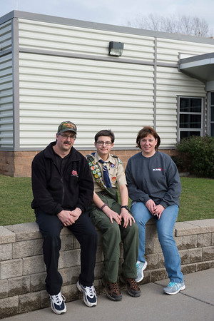 Joed Viera/Staff Photographer Lockport, NY-Life Scout Parker Gurnett sits outside of the Niagara County Communications Center. Gurnett with his parents Wolcottsville Volunterer Fire Chief Paul and volunteer firefighter Darlene Gurnett.  Gurnett, 14, is planning to build a memorial to firefighters outside of the center for his Eagle Scout project.