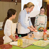 Joed Viera/Staff Photographer Barker, NY-Barker 6th graders Abby Heidemann, left and Cate Mallon, right, both 11, make bread with King Arthur Flour instructor Amy Driscoll during a presentation at Barker Central School.
