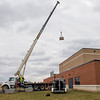 JOED VIERA/STAFF PHOTOGRAPHER-Pendleton, NY-Crews use a crane to lift tiles up to Starpoint's roof Thursday morning. The schools roof suffered damage from Wednesday's high winds.