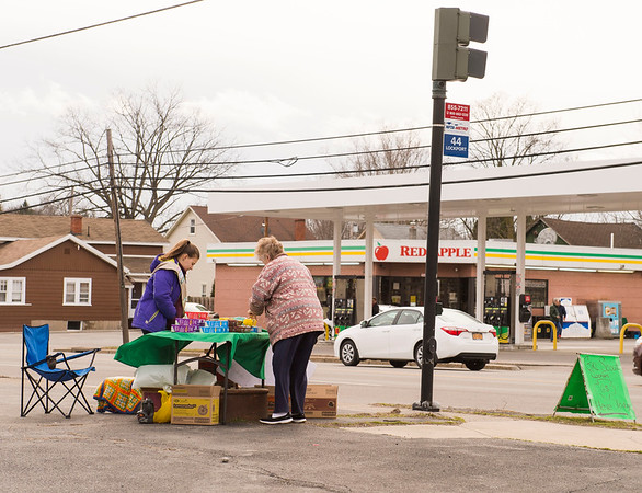 JOED VIERA/STAFF PHOTOGRAPHER-Lockport, NY-Diane Britt purchases Peanut Butter Patties, Shortbread and Lemonades from Girl Scout Jessica Zysek's stand on the corner of  Willow Street and South Transit Road.