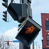 JOED VIERA/STAFF PHOTOGRAPHER-Lockport, NY-A cross walk sign hangs from wires on the corner of W. Main Street and South Transit Road.