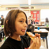 Joed Viera/Staff Photographer Lockport, NY-Julius Whitcomb, 9, enjoys a slice of pizza during Mary McIntosh's 3rd grade class at George Southard Elementary School.  Students at the school received 1,000 books and a pizza party from Pizza Hut's The Literacy Project.