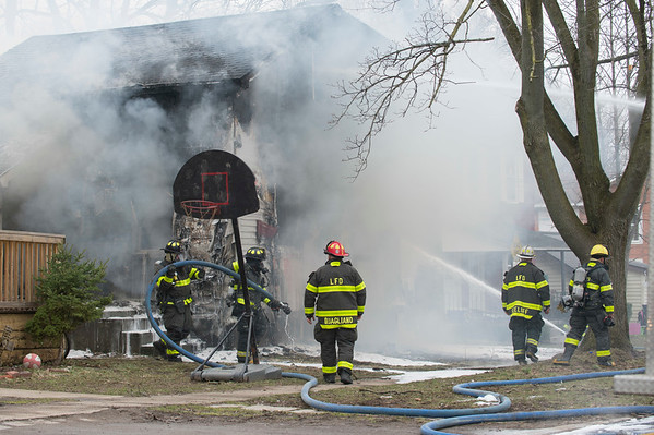 Joed Viera/Staff Photographer Lockport, NY-Lockport City Firefighters work on extinguishing a structure fire on Spalding Street.
