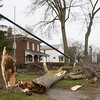 JOED VIERA/STAFF PHOTOGRAPHER-Lockport, NY-A fallen tree by the Lockport Historical Society stretches a power line down to the ground on Niagara Street.