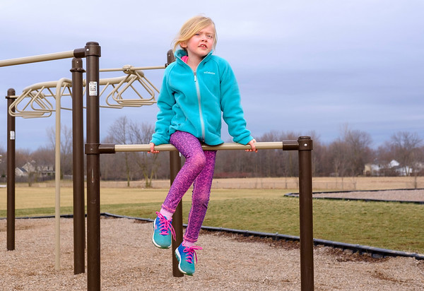 JOED VIERA/STAFF PHOTOGRAPHER-Lockport, NY- Madelyn Kelley, 7, plays on the playground after class at Roy Kelly Elementary School.
