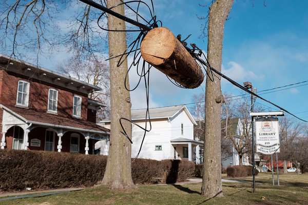 JOED VIERA/STAFF PHOTOGRAPHER-Lockport, NY-The remains of a utility pole dangles from wires outside of the Lockport Historical Society on Niagara Street.