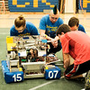 Lockport High School's FIRST robotics team the Warlocks' Keirstan Farina, 16, Oscar Handley, 17, Jeremy Stoddard, 14, and Antonio Faraci, 18, work on their robot before a presentation in the school gym on Monday.