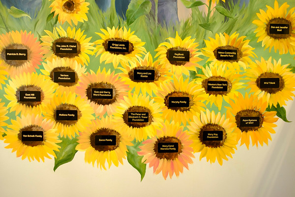 Joed Viera/Staff Photographer Lockport, NY-Plaques of Sponsor names fill the inside of painted sunflowers on the YWCA's mural by Kathleen Giles.