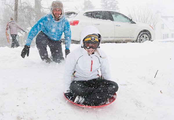 JOED VIERA/STAFF PHOTOGRAPHER-Lockport, NY-Chris Lavocat pushes Meredith Chamberland while sledding down a hill at Lockport Town & Country Club.