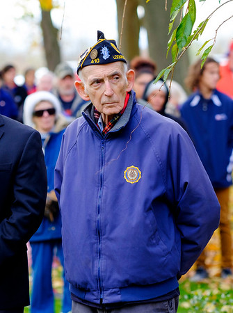 Joed Viera/Staff Photographer Lockport, NY-David Knight waits to place a wreath on the World War I Memorial during the Veterans Day ceremony at Outwater Park.