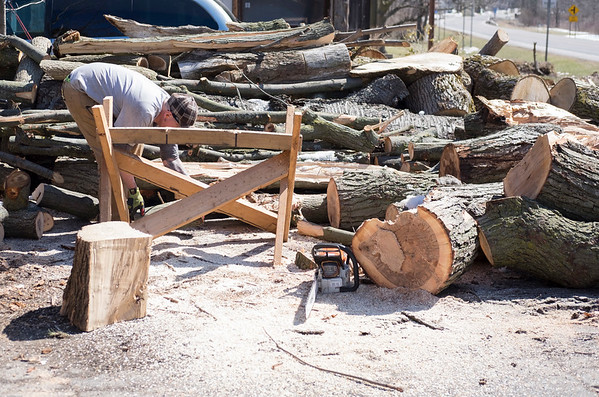 Joed Viera/Staff Photographer Terrys Corners, NY-Thomas Rachow cuts firewood outside his home on Mill Road. Rachow has been gathering unwanted wood from craigslist ads and cutting it to heat his home and sell. To purchase Rachow's wood you can contact him at 716-343-4301