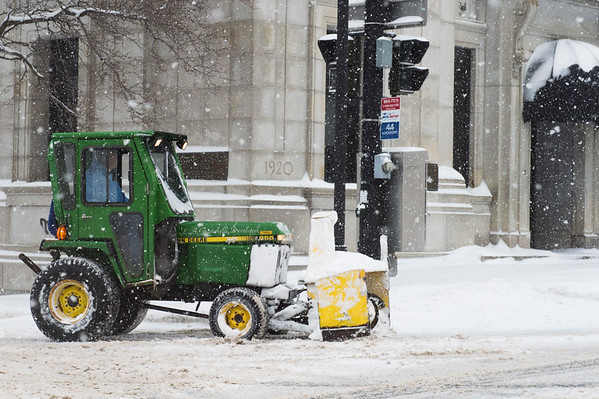 JOED VIERA/STAFF PHOTOGRAPHER-Lockport, NY-A John Deere tractor in between shoveling sidewalks along Pine Street and Main Street.