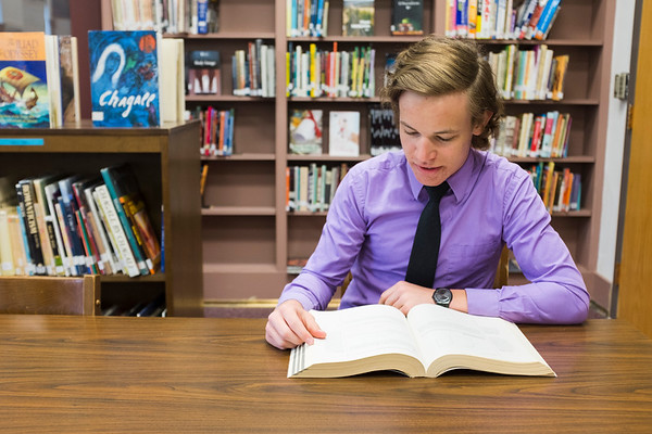 JOED VIERA/STAFF PHOTOGRAPHER-Barker, NY- Barer High School senior Josh Richbart looks over an SAT book in the school library.