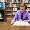 JOED VIERA/STAFF PHOTOGRAPHER-Barker, NY- Barer High School senior Josh Richbart looks over an SAT book in the school library.