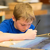 JOED VIERA/STAFF PHOTOGRAPHER-Pendleton, NY-Starpoint 4th grader Eric Wolf, 10, makes paints a beach scene feature real sand and shells to sell at Starpoint's 4th annual Arts and Crafts Show.