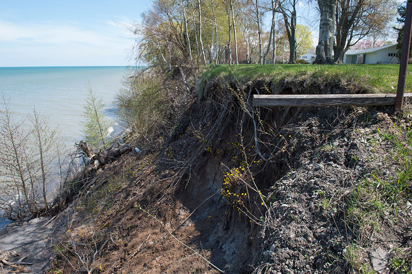 JOED VIERA/STAFF PHOTOGRAPHER-Wilson, NY-Rising Lake Ontario water levels have caused extensive corrosion and damages to Joseph A. Jastrzemski's shoreline property.