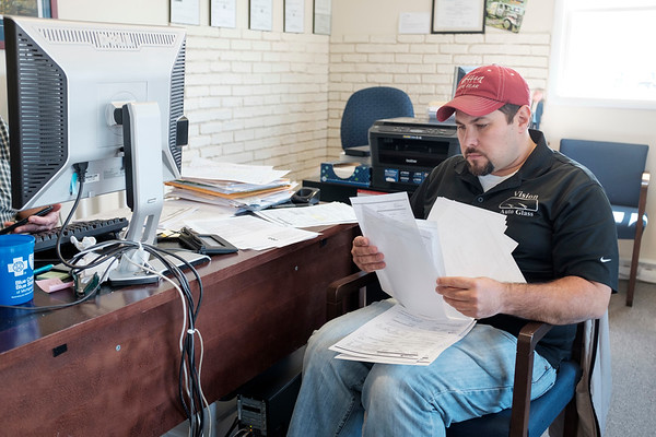 JOED VIERA/STAFF PHOTOGRAPHER-Lockport, NY-David Keleher sorts through some documents while preparing his 2016 tax returns at Liberty Tax.