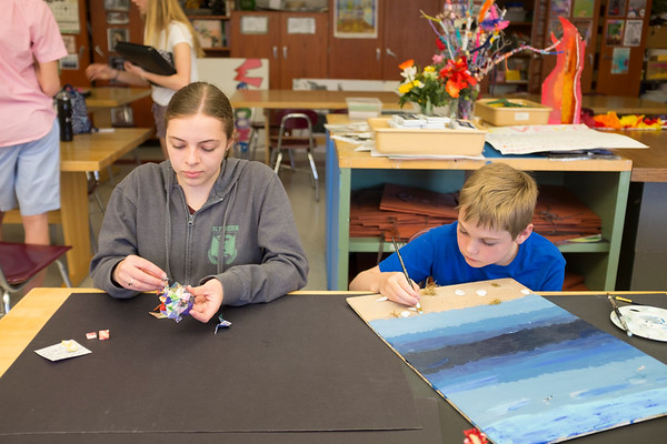 JOED VIERA/STAFF PHOTOGRAPHER-Pendleton, NY-Starpoint 8th grader Anna Schell, 14, makes modular origami, as 4th grader Eric Wolf, 10, makes paints a beach scene feature real sand and shells to sell at Starpoint's 4th annual Arts and Crafts Show.