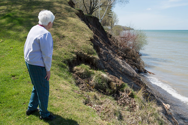 JOED VIERA/STAFF PHOTOGRAPHER-Wilson, NY-Rita Eaton surveys damage to her shoreline property caused by rising Lake Ontario water levels.