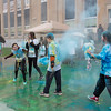 "JOED VIERA/STAFF PHOTOGRAPHER-Lockport, NY- Students throw colored powder at each other after participating in the Lockport Lions ""My School Color Run"" during the Family Literacy Night and Fitness Fair at North Park."