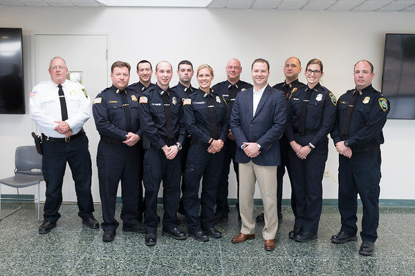 JOED VIERA/STAFF PHOTOGRAPHER-Lewiston, NY- Lockport Police Officers stand with Senator Robert Ortt after graduating from the Crisis Intervention Program.