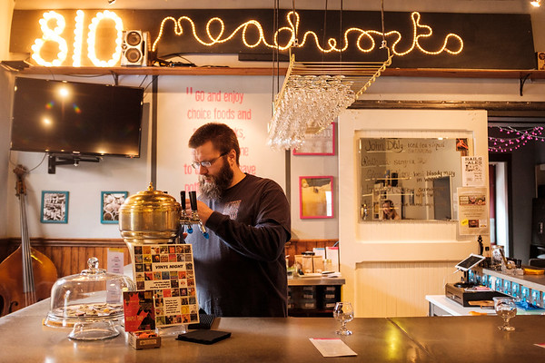 Bryan DeGraw works behind the bar at 810 Meadworks in Medina.(Joed Viera)