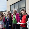 "JOED VIERA/STAFF PHOTOGRAPHER-Gasport, NY-Hundreds of Royalton-Hartland Elementary students sing ""Plant a Tree for Your Tomorrow"" as Bill Hahn and Brian Wagner from Stedman Old Farm Nurseries plant a 6 year old Sycamore tree in front of the school as a part of their Arbor Day celebration. Each student in Pre-K through 4th grade took home a Blue Spruce Seedling to plant. In the past four years the school has distrubuted more than 2,000 spruces to students."