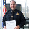 JOED VIERA/STAFF PHOTOGRAPHER-Lewiston, NY- Lockport Police Lt. Terry Gill holds a certificate after graduating from the Crisis Intervention Program.