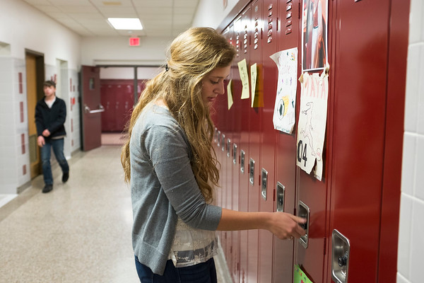 JOED VIERA/STAFF PHOTOGRAPHER-Barker, NY- Barker High School senior Maya Gooding opens her locker.