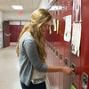 JOED VIERA/STAFF PHOTOGRAPHER-Barker, NY- Barker High School senior Maya Gooding opens her locker.